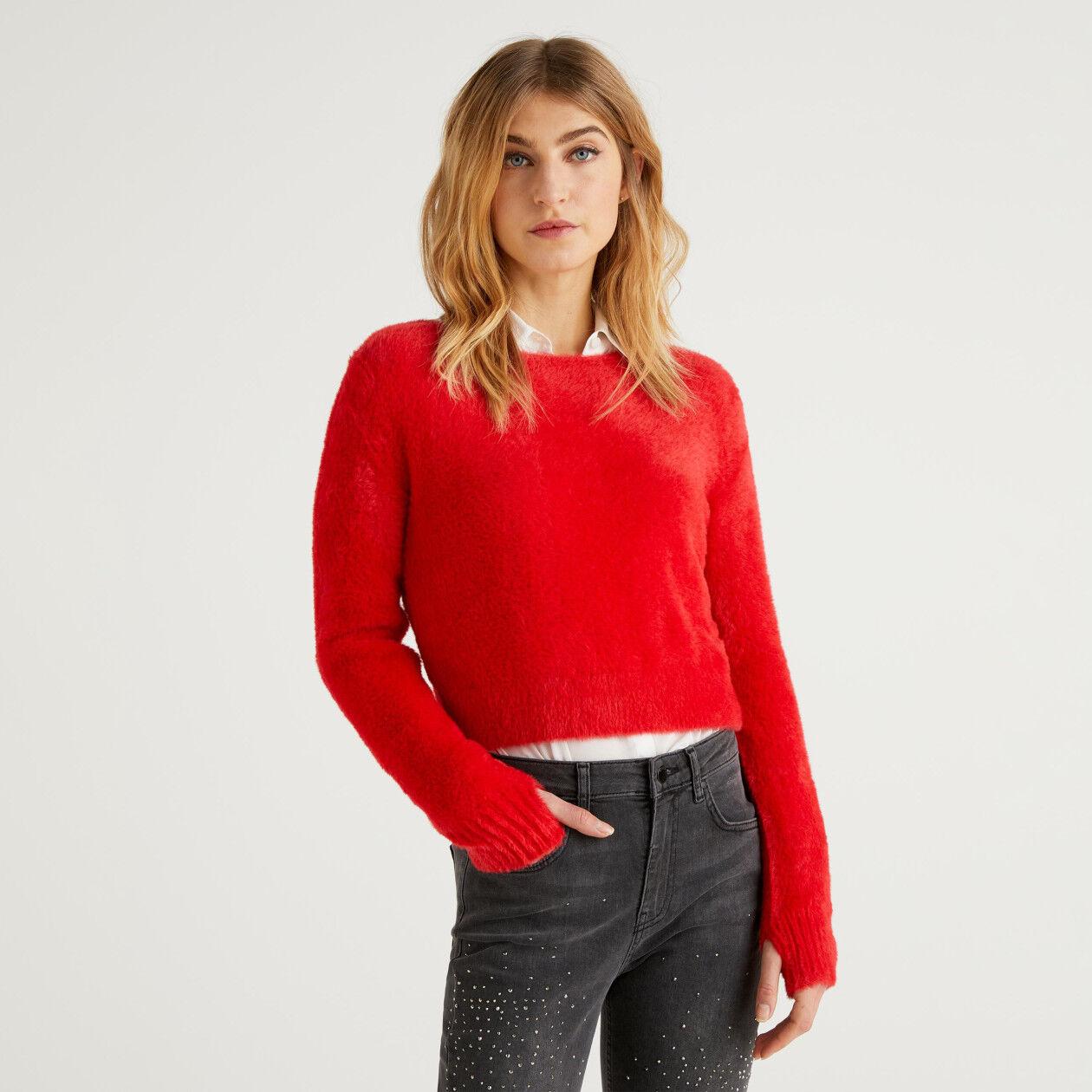 Sweater in long-haired yarn.
