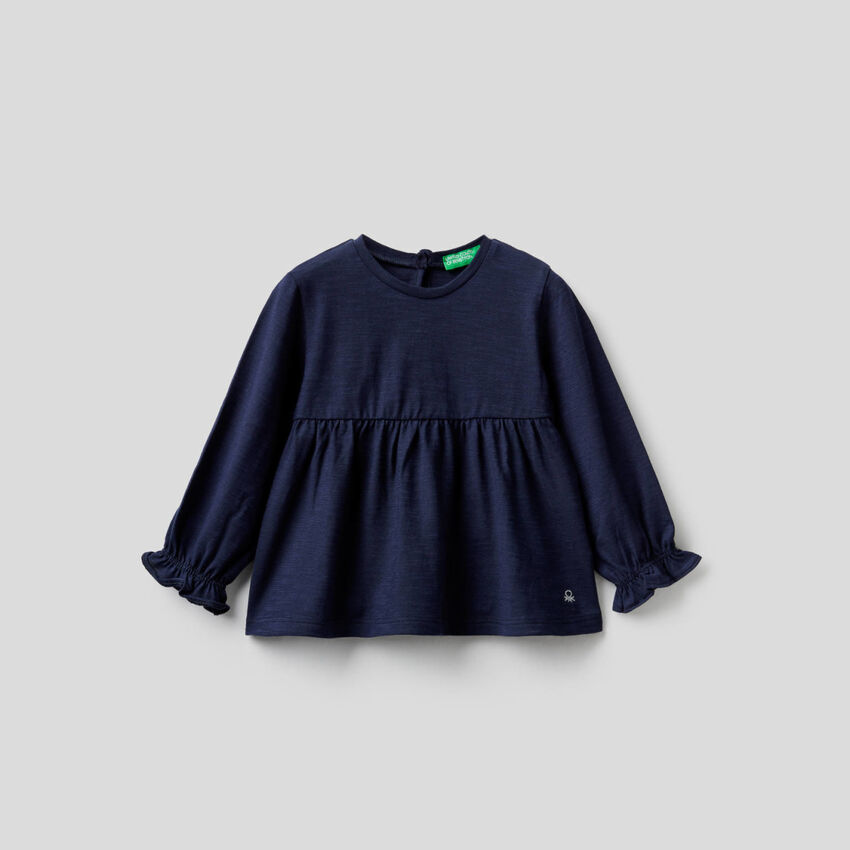 Blouse in 100% organic cotton with frill